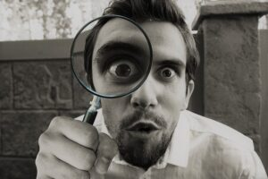 inspection-with-magnifying-glass